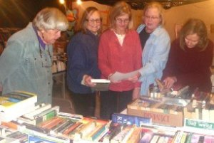 FRIENDS packing up books for donations to local organizations