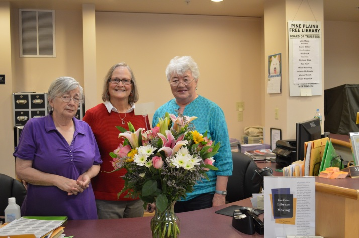 Library Workers Day 2014. Marguerite Hill, Director; Jean Osofsky, FRIEND; Rae Hart, Coordinator of Volunteers. Flowers presented by FRIENDS and Board of Trustees.