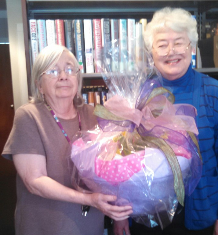 Director of Pine Plains Library Marguerite Hill and Coordinator of Volunteers Rae Hart accept a gift from the FRIENDS of the Pine Plains Library in honor of National Library Workers Day