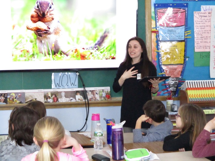 Courtney Scheinmel, author of the Kindness Club series, explains to third graders from Seymour Smith Intermediate Learning Center, what it means to be an author. Students also participated in a kindness writing activity with the author.